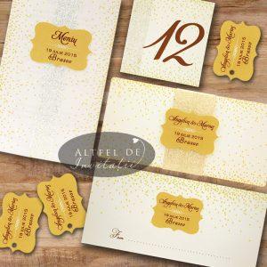 Papetaria Sampanie si Papioane este eleganta si deosebita prin culorile calde si imprimeul de tip confetti - altfeldeinvitatii.ro